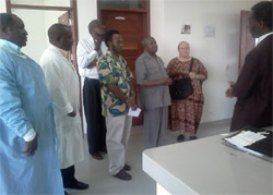 L to R Dr. Changalucha(CAB member), Dr. Masalu,  Capt. Magatti, Father Aloys(CAB member), Dr. Makwami(CAB Member)  and Dr. Esther.  Standing in front of the group is Dr. Kahima.