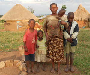 BL families normally come from rural environments such as this one, that shows a mother with four of her children, multiple thatched houses in a group, and livestock kept in bush-fenced enclosures adjacent to the dwellings.