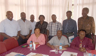 Group photo after a CAB meeting. CAB members seated R-L Father Aloyce, Dr. Makwani, Ms Pamela. Standing L-R, Dr. Masalu-PI, Dr. Changalucha-CAB provisional chairman, Herry, Mafimbo and Hillary-Study staff, Dr. Kahima-BMC pathologist and Capt. Magatti – Study Coordinator